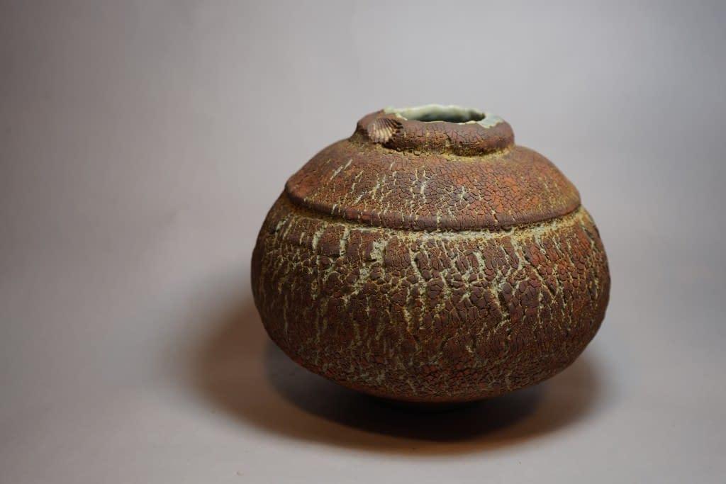 stoneware vase with shell decoration