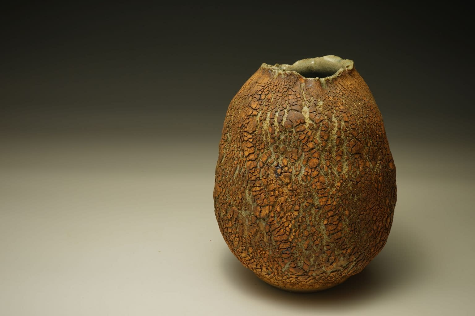 Stoneware vase with earth textured surface (1)