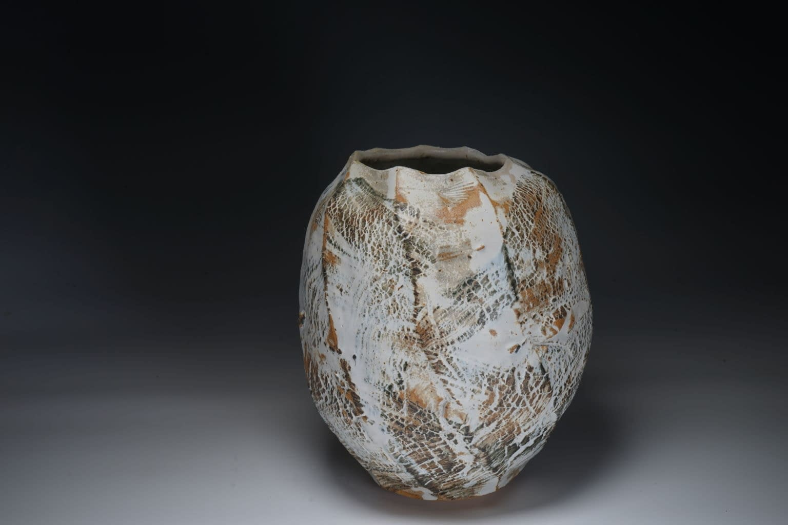 Thrown and cut sided abstract vase