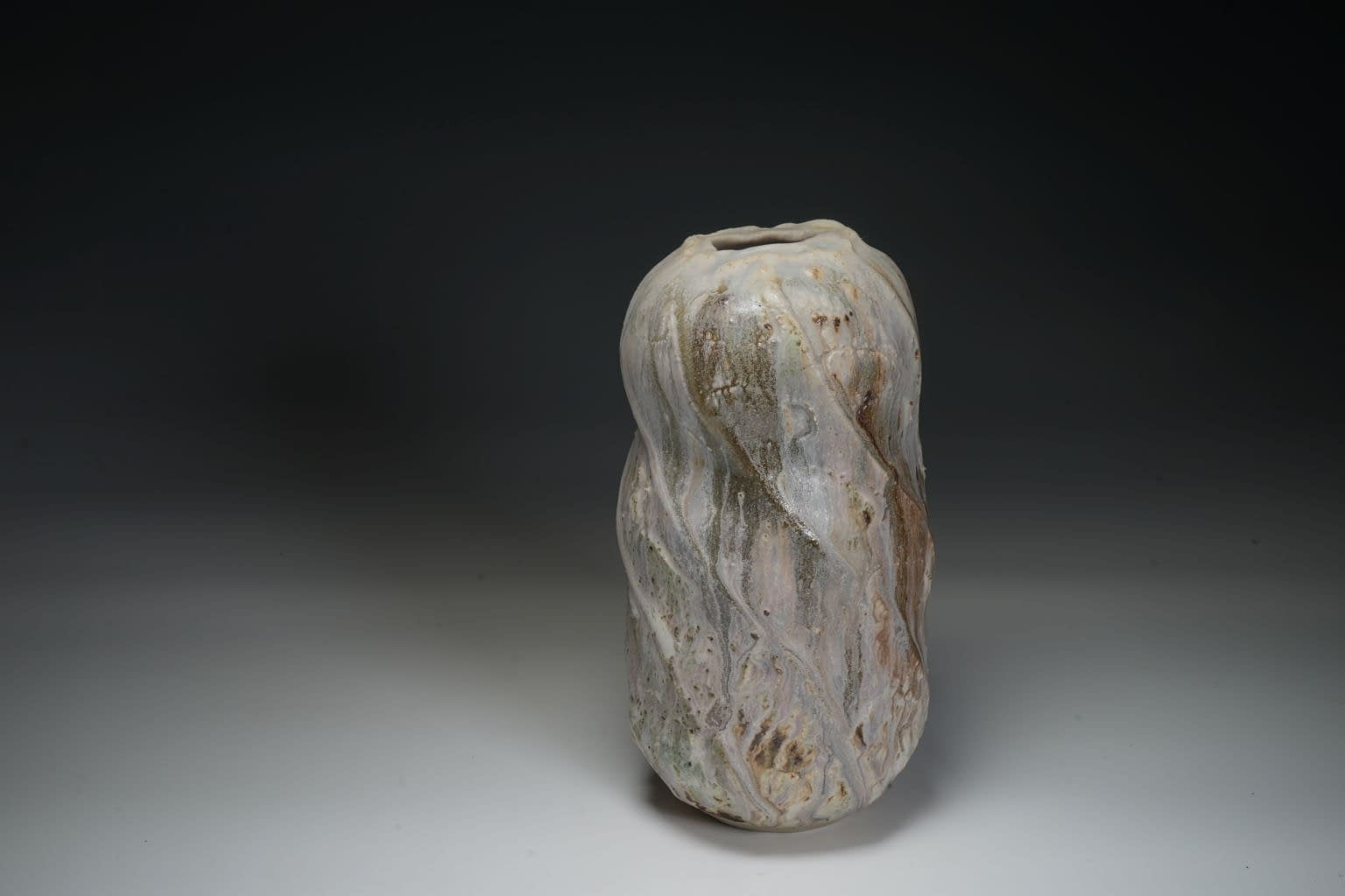 Thrown and cut sided abstract tall vase