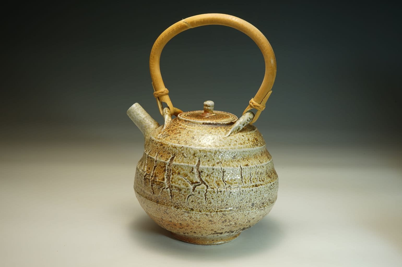 Wood salt fired teapot with sculptured surface