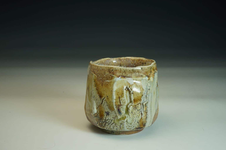 Wood-fired Chawan tea bowl. Sculptured surface with glaze and salt.