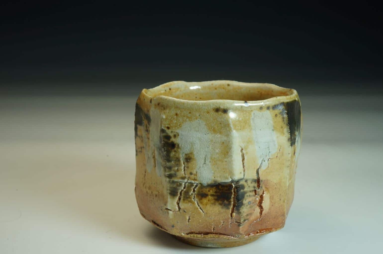 Wood-fired Chawan tea bowl. Sculptured surface with Shino glaze and salt.