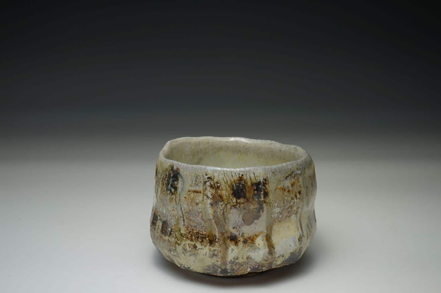 Wood-fired tea bowl, thrown and cut sided, one-off piece. Natural crystallized Celedon glaze.
