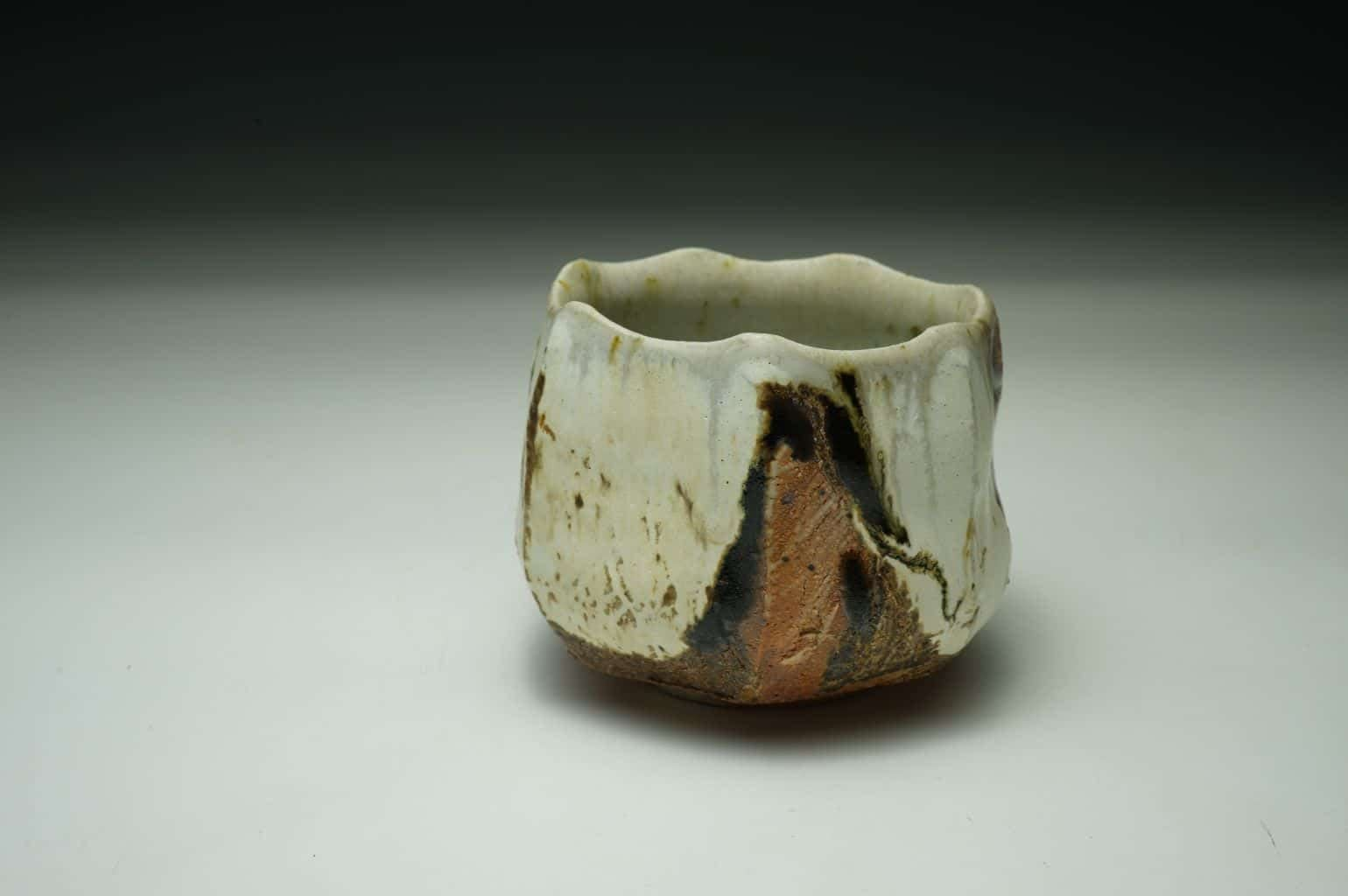 Wood-fired matcha tea bowl thrown and cut sided. One-off piece. Natural Celedon glaze inside.
