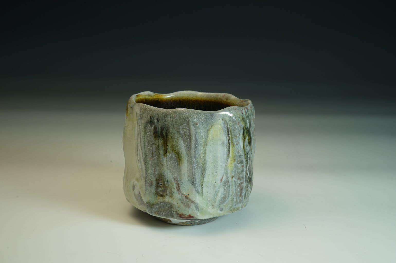 Beautiful  Tea Bowl/chawan wood fired with salt tea bowl. Stoneware/porcelain slip. Tenmoku glazed inside.
