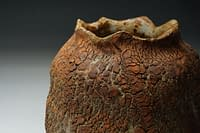 Earth texture cut sided vase